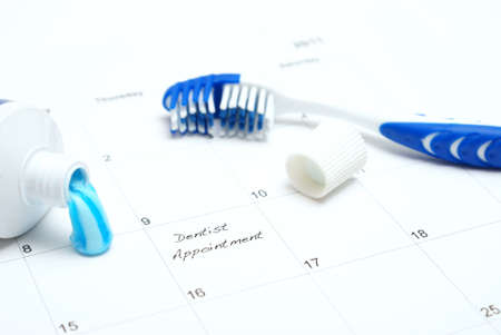 A note of a dentist appointment on a calendar reminds the patient. photo