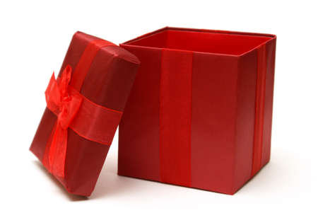 blank box: An empty red gift box with the lid off for easy insert of your merchandise in a photo editing program. Stock Photo