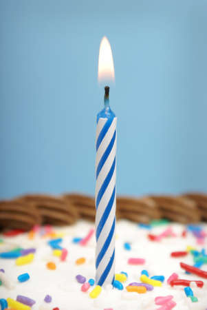 candle: A celebration using a candle and some cake. Stock Photo