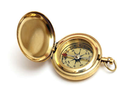 An isolated brass compass with its hinged cover opened for viewing the directional arrows. Stock Photo