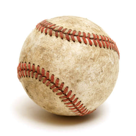 hardball: An isolated shot of a well used baseball.
