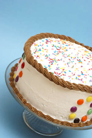 occasions: A decorated cake rests on a blue background to celebrate many occasions.