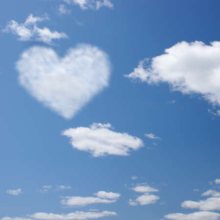 shaped: An open blue sky with a heart shaped in the clouds.