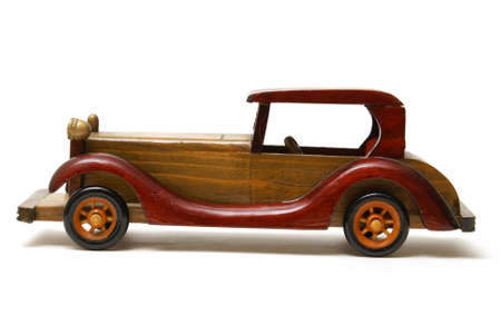 An isolated shot of a wooden toy car for the childs collection. Imagens - 9488878