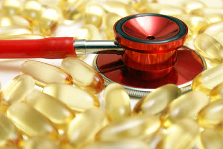 A macro shot of a stethoscope and Omega-3 supplements to address the benefits of their intake for a healthy heart. photo