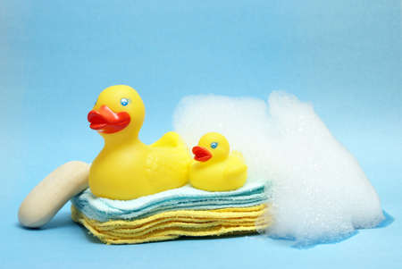 A group of rubber duckies and other bathing items come together to conceptualize a juveniles bath time.