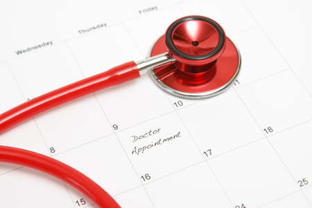 appointment: A scheduled doctors appointment is wrote on a calendar for a patient who is in need of their services.