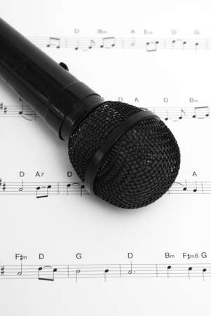 A microphone and sheet music together.  The sheet is an uncopyrighted Christmas carol of The First Noel. Stock Photo - 9779432