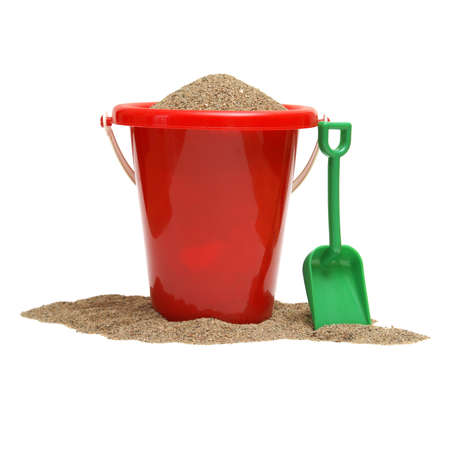 buckets: An isolated shot of a bucket of sand for the childrens play time either on vacation, at the beach, or just at home in the sandbox. Stock Photo