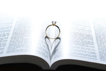 ring light: A wedding ring and the light of God, put together, make the symbol of love upon the marriage. Stock Photo