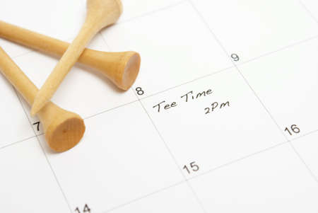 A note on a calendar reminds a golfer of his afternoon game to be played. Stock Photo