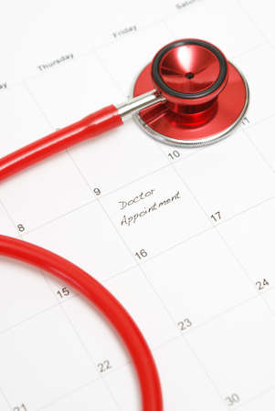 A scheduled doctors appointment is wrote on a calendar for a patient who is in need of their services. photo