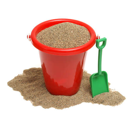 just in time: An isolated shot of a bucket of sand for the childrens play time either on vacation, at the beach, or just at home in the sandbox. Stock Photo
