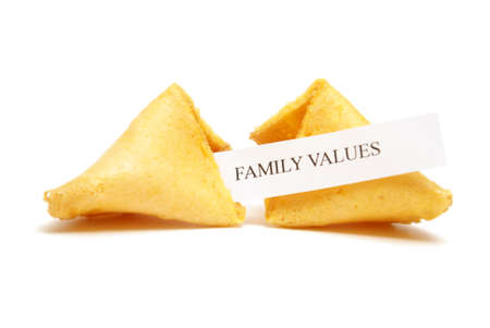 stating: A cracked open fortune cookie stating family values.