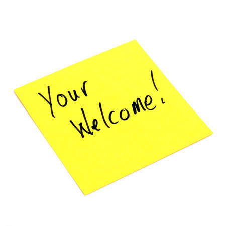 A yellow sticky note is isolated on white with a handwritten note giving welcoming where it is due. Stock Photo - 9779480