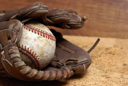 hardball: A low contrast image of a well used hardball and glove for those who love the sport of baseball. Stock Photo