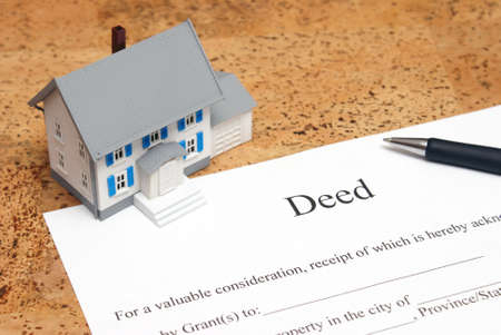 A scale house on some forms for a deed to conceptualize on the financial investment. photo