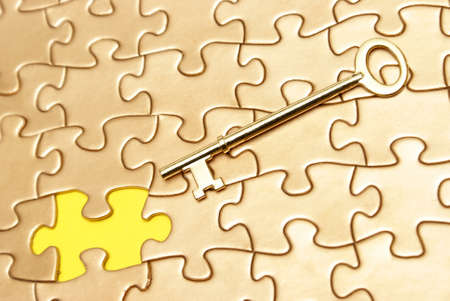 A conceptual image with a golden puzzle and skeleton key. photo