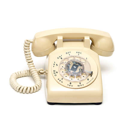 rotary dial telephone: An isolated shot of a traditional rotary phone.