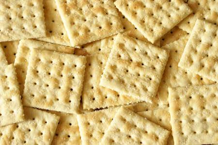 heaping: A macro shot of a heaping pile of soda crackers.