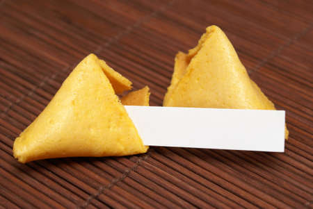 A fortune cookie with a blank paper for your message. Stock Photo - 10019833