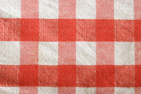 A macro shot of a red checkered tablecloth. Stock Photo