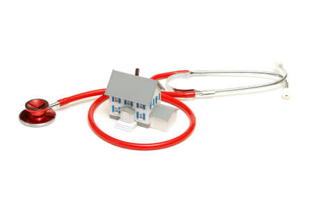 An isolated stethoscope and house represent home nursing or other concepts.