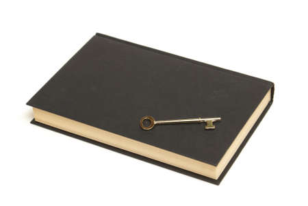 A skeleton key and old book hold the secrets to many things. Stock Photo - 10019849