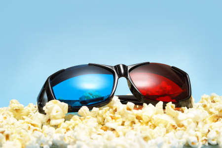 sleek: A pair of sleek 3D glasses rests on top of a pile of fresh popcorn.