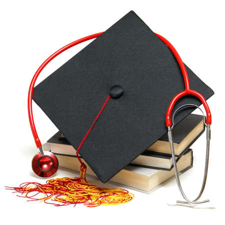 medical education: An isolated stethoscope and mortarboard represent a graduating healthcare professional.