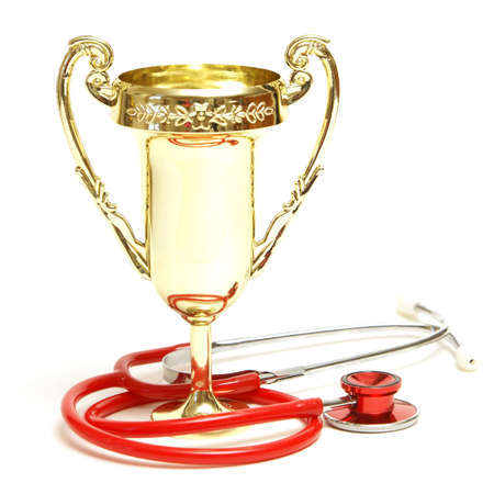 stethoscope: A trophy and stethoscope represent some award winning healthcare professionals. Stock Photo