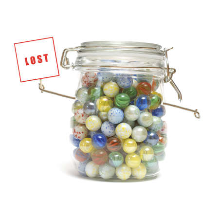 losing memory: An isolated shot of a character created from marbles in a glass jar to represent loosing your mind. Stock Photo