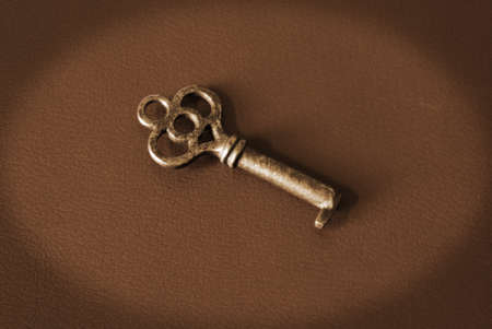 An antique key holds access to many old secrets. Stock Photo - 10301733