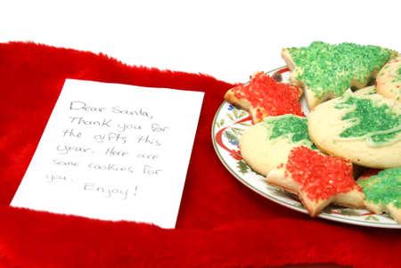generosit�: Un piatto di biscotti e una piccola nota a Santa rendendo grazie per la sua generosit�. Archivio Fotografico