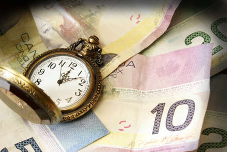 canadian currency: A conceptual image referring to the saying time is money.