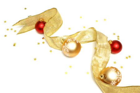 golden: A few glimmering holiday items on a white background. Stock Photo