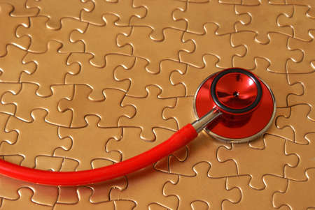 A concept of networked healthcare using a stethoscope and a jigsaw puzzle. Standard-Bild