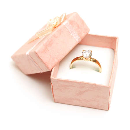 A beautiful diamond ring in a pink jewelry box. photo