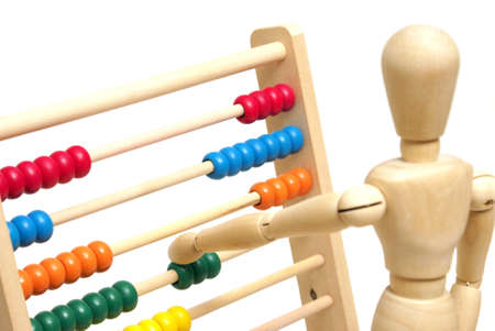 artists mannequin: A mannequin positions a few beads on the abacus to solve his math.