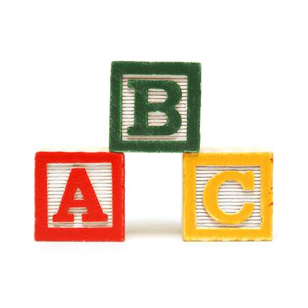 英語を学ぶために若者の心の 3 アルファベットブロック。 写真素材