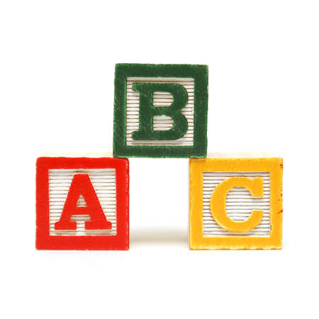 yellow block: Three alphabet blocks for the young mind to learn the english language.