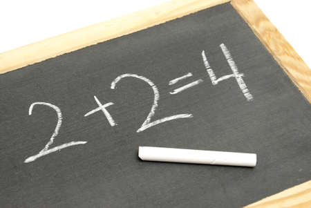 equals: A young student has solved a basic math equation on a chalkboard.