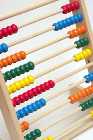 A childrens abacus with many colorful beads to help stimulate the mind in learning to count. photo