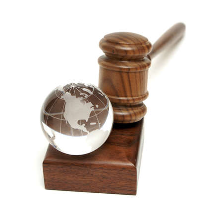 law business: A globe rests near a gavel for worldly concepts like global auctions and world order.