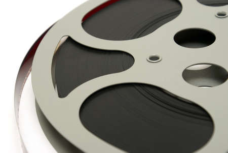 A closeup shot of a 16mm movie reel for projection playing at theaters. photo