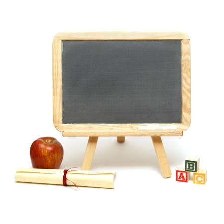 A blank chalkboard with other school items for displaying your message. photo