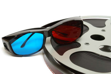 A filmstrip and a pair of 3D glasses on a white background. photo