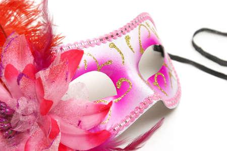 お祭りであなたの身元を隠すための白い背景の上のフェミニンなベネチアン マスクです。 写真素材