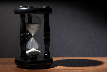 The sands of time trickle through this hourglass. Stock Photo - 11499657