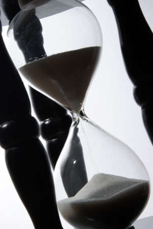 The sands of time trickle through this hourglass. photo